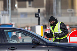 """© Licensed to London News Pictures.13/02/2021, London, UK. A workers speaks to a woman outside the drive-through testing centre in Heathrow Airport in West London. Arriving passengers from 22 """"red list"""" countries need to quarantine in the hotel rooms to prevent a new spread of coronavirus. Photo credit: Marcin Nowak/LNP"""