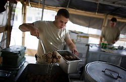 In a scene rarely witnessed in the era contractors, Army cooks prepare dinner in a field kitchen for the paratroopers of 2-319 2BCT 82nd Airborne Division at their outpost on the northern edges of Adhamiya in Baghdad on Monday April 23, 2007. With the Army moving  troops out of large bases and into their areas of responsibility, soldiers temporarily no longer have access to the voluminous portions and variety of food provided by contractors like Halliburton.