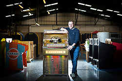 "© Licensed to London News Pictures. 27/11/2016. Leeds UK. Picture shows MD of Sound Leisure Chris Black with the Rocket jukebox the only vinyl playing jukebox being produced in the world. A resurgence in the popularity of Vinyl has prompted Leeds based Jukebox manufacturer Sound Leisure to build a new Vinyl playing Jukebox called the Rocket making them the only company in the world building a jukebox that play's vinyl record's. The first of the new Jukeboxes have started to roll of the production line in Yorkshire at a cost of £8,000 & can play 140 songs. The Rocket hold's 70 7"" record's on a rotating mechanism, has a D4 amplifier with a 60W output & a remote control. Demand for the Rocket is high with order's from across the globe. Photo credit: Andrew McCaren/LNP"