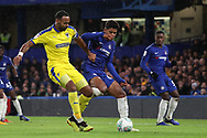 AFC Wimbledon midfielder Liam Trotter (14) battles for possession with Faustino Anjorin of Chelsea (64) during the EFL Trophy match between U21 Chelsea and AFC Wimbledon at Stamford Bridge, London, England on 4 December 2018.