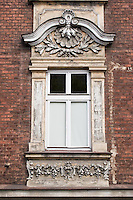 decorative window of an old building in Podgorze area of Krakow Poland