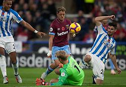Jonas Lossl of Huddersfield Town saves from Javier Hernandez of West Ham United (C) - Mandatory by-line: Jack Phillips/JMP - 10/11/2018 - FOOTBALL - The John Smith's Stadium - Huddersfield, England - Huddersfield Town v West Ham United - English Premier League