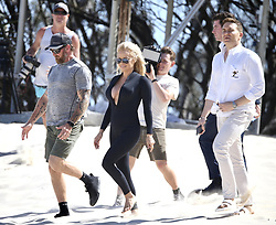 AU_1799407 - *EXCLUSIVE* ** RIGHTS: WORLDWIDE EXCEPT IN AUSTRALIA, FIJI, NEW ZEALAND, FRENCH POLYNESIA ** Gold Coast, AUSTRALIA  - Pamela Anderson films Ultra Tune TV Ad on Gold Coast Beach<br />