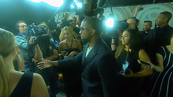 "EXCLUSIVE: ** NO USA TV AND NO USA WEB ** Kanye West gave the folks at the Ralph Lauren party an ultimatum -- kick a certain reporter out of the event, or he'll book it. Kanye was on the red carpet at the Ralph Lauren 50th Anniversary Fashion Show in Central Park Friday night, when one of his handlers delivered the threat to what looks like an event organizier. Kanye then jumped in and made it clear ... he wanted the reporter in question out of the joint, STAT. We're told the beef was over a question the reporter asked about the feud between Kim Kardashian and Tyson Beckford. Remember last month, when Tyson shaded Kim over her body and Kim fired back by saying, ""Sis we all know why you don't care for it"" ... lots of people took that as a homophobic slur. The reporter made a hasty exit before she could get kicked out. Meanwhile, back at the ranch, Tyson was at the Plaza -- yep, where Cardi B attacked Nicki Minaj -- and said he didn't see the fight, but decided to say this ... ""I carry a gun. I'm not allowed to get in fights."". 08 Sep 2018 Pictured: Kanye West. Photo credit: TMZ/MEGA TheMegaAgency.com +1 888 505 6342"