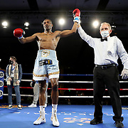 Brandon Lynch celebrates a victory over Vincent Hadley during a One For All Promotions boxing event at the Caribe Royale Orlando Events Center on Saturday, February 20, 2021 in Orlando, Florida. (Alex Menendez via AP)