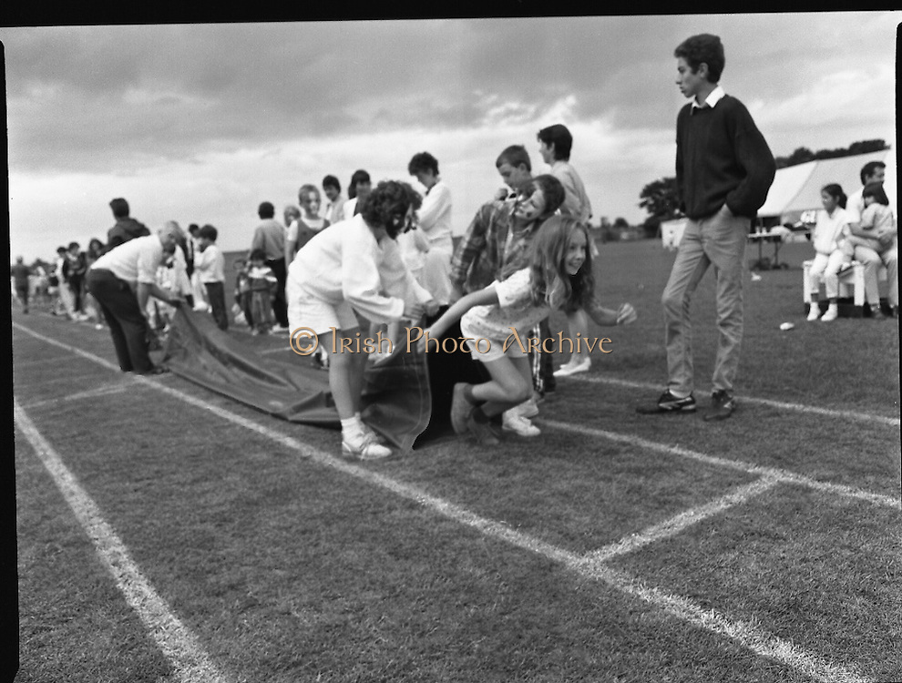 """Guinness Family Day At The Iveagh Gardens. (R83)..1988..02.07.1988..07.02.1988..2nd  July 1988..The family fun day for Guinness employees and their families took place at the Iveagh Gardens today. Top at the bill at the event were """"The Dubliners"""" who treated the crowd to a performance of all their hits. Ireland's penalty hero from Euro 88, Packie Bonner, was on hand to sign autographs for the fans...Picture shows the children taking part in the obstacle race during the family day."""