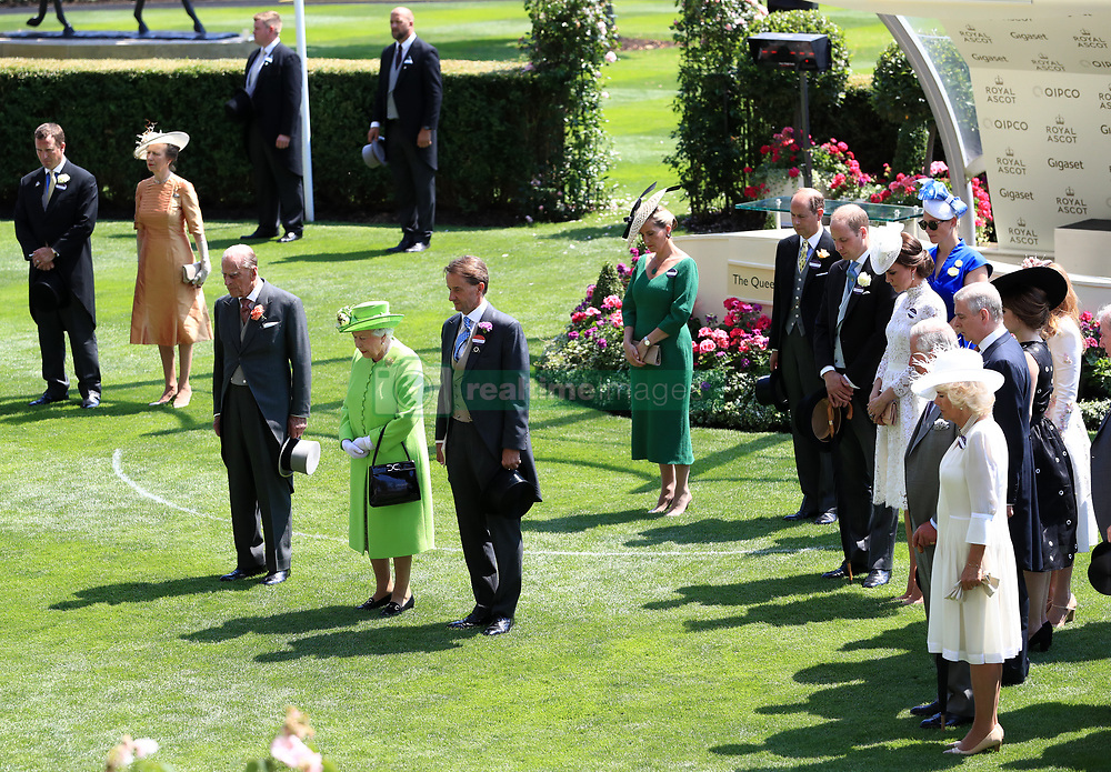 Her Majesty The Queen and the Royal Party observe a minute's silence in light of recent tragic events around Britain during day one of Royal Ascot at Ascot Racecourse.