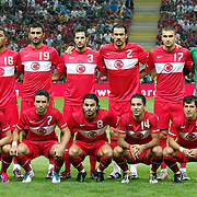 Turkey's players (Left to Right) (Front Row) Serdar KESIMAL, Gokhan GONUL, Selcuk INAN, Arda TURAN, Emre BELOZOGLU, (Left to Right) (Back Row) Colin Kazim RICHARDS, Selcuk SAHIN, Hakan BALTA, Servet CETIN, Burak YILMAZ, goalkeeper Sinan BOLAT during their a international friendly soccer match Turkey betwen Estonia at TT Arena Istanbul August 10, 2011. Photo by TURKPIX