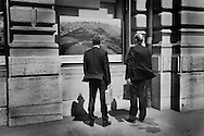 Waiting for a meeting at Credit Suisse, looking at advertising on the exterior of the bank's head quarters, on Paradeplatz in the centre of Zurich.