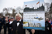 Pro Brexit Leave supporter and Boris Johnson lookalike, with his Churchill quote placard  in Westminster on Brexit Day as the UK prepares to leave the European Union on 31st January 2020 in London, England, United Kingdom. At 11pm on Friday 31st January 2020, The UK and N. Ireland will officially leave the EU and go into a state of negotiations as to the future arrangement and trade agreement, while adhering to EU rules until the end of 2020.