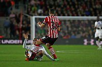 Football - 2016 / 2017 League Cup - Round 4: Southampton vs Sunderland<br /> <br /> Wahbi Khazri of Sunderland launches into a tackle on Southampton's Sam McQueen at St Mary's Stadium Southampton <br /> <br /> COLORSPORT/SHAUN BOGGUST