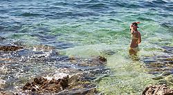 THEMENBILD - URLAUB IN KROATIEN, eine junge Frau beim Schnorcheln in der Adria, aufgenommen am 03.07.2014 in Vrsar, Kroatien // a young woman snorkeling in the Adriatic Sea near Vrsar, Croatia on 2014/07/03. EXPA Pictures © 2014, PhotoCredit: EXPA/ JFK