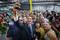 Former Los Angeles Mayor Antonio Villaraigosa poses for a selfie with employees of BYD. BYD holds its Grand Opening of a new wing, expanding its manufacturing facility for advanced technology battery-electric transit buses in Lancaster, CA. . TOctober 6, 2017. Photo by David Sprague