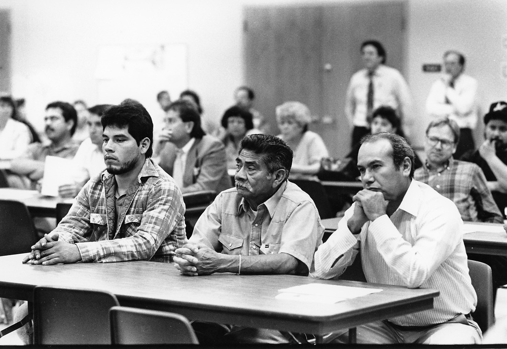 ©1991 PARENTS SPEAKING OUT: at public meeting regarding the closing of he high school,  Travis High, Austin, Texas.