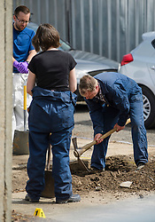 © Licensed to London News Pictures. 16/05/2017. London, UK. Members of a police search team use digging equipment as the search continues for the body of murdered schoolgirl Danielle Jones at a block of garages in Stifford Clays in Thurrock, Essex. The 15-year-old was last seen on Monday June 18 2001 at about 8am when she left her home in East Tilbury to catch the bus to school.  Photo credit: Ben Cawthra/LNP