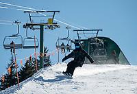 "Snowboarders and skiers enjoy a ""bluebird"" day at Gunstock Mountain on Friday.  ©2021 Karen Bobotas Photographer"