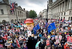 © Licensed to London News Pictures. 04/06/2019. London, UK. A giant effigy of US President Donald Trump is carried by protestors as they fill Whitehall in central London. On the 2nd day of President Trump's State Visit to the UK he is meeting outgoing Prime Minister Theresa May before attending 75th Anniversary of D-Day commemorations in Portsmouth and France tomorrow. Photo credit: Peter Macdiarmid/LNP