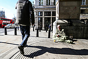 """A homeless person is seen enjoying the sunshine nearby Westminster Abbey, Parliament Square in London on Tuesday morning, March 24, 2020. Homeless people are at particular risk of contracting the coronavirus with the systems that care for them poorly equipped to handle a major outbreak. Vigilant hygiene can prevent transmission, health experts say, but that is likely to be a challenge for people living without homes. Hundreds of homeless people in London are being housed in hotels to self-isolate to provide them with """"vital protection"""" from the coronavirus, the city's mayor, Sadiq Khan, announced. Three hundred rooms have been made available in two hotels for the next 12 weeks, the mayor's office said in a statement. An estimated 320,000 people are homeless in the UK, according to the latest research by Shelter. This equates to one in every 201 Brits and was an increase of four per cent on the previous year's number.<br /> (Photo/Vudi Xhymshiti)"""