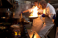 Xavier Mascareñas/Treasure Coast Newspapers; Osceola Bistro's Chef Christopher Bireley, of Vero Beach, controls a flame kicked up while preparing the first dish of the night, his local Florida Gulf shrimp pasta, at Vero's Top Chef Challenge on Monday, April 3, 2017, at Bent Pine Golf Club in Vero Beach. The event was held to benefit The Hope for Families Center in Vero Beach.