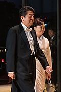 De Japanse keizer Naruhito heeft officieel de troon aanvaard en de belofte afgelegd dat hij zijn plicht als symbool van de staat zal vervullen. De 59-jarige Naruhito deed dat in een eeuwenoude ceremonie in de belangrijkste zaal van het keizerlijke paleis in Tokio in aanwezigheid van staatshoofden en gasten uit meer dan 180 landen.<br /> <br /> The Japanese emperor Naruhito has officially accepted the throne and made the promise that he will fulfill his duty as a symbol of the state. The 59-year-old Naruhito did that in an ancient ceremony in the main hall of the Imperial Palace in Tokyo in the presence of heads of state and guests from more than 180 countries.<br /> <br /> Op de foto / On the photo:   Japan's Prime Minister Japan's Prime Minister Shinzo Abe, left, and his wife Akie