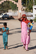 Young Indian woman with her children in Narlai village in Rajasthan, Northern India