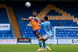 Rollin Menayese of Mansfield Town runs the ball past Sam Edozie of Manchester City - Mandatory by-line: Ryan Crockett/JMP - 08/09/2020 - FOOTBALL - One Call Stadium - Mansfield, England - Mansfield Town v Manchester City U21 - Leasing.com Trophy