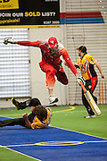 A South Australian batsman leaps over a Western Austraian fielder at the 2011 Australian Open Indoor Cricket Championships, Ballajura, Perth, Western Australia <br /> RIGHTS MANAGED LICENSE AVAILABLE FROM www.picade.com<br /> reference no: 5005E000000000S1L3585