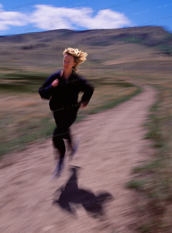 Deena Drossin, long-distance runner on path near Boulder, Colorado.  She has won several marathon's and long distance races including the Bolder Boulder and the New York City Marathon.