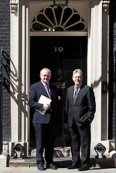© Licensed to London News Pictures. 14/06/2013. London, UK. The Northern Irish First Minister Peter Robinson (R) and Deputy First Minister Martin McGuinness are seen on Downing Street in London today (14/06/2013) after they met with British Prime Minister David Cameron to sign off an economic package for Northern Ireland in advance of the G8 summit. Photo credit: Matt Cetti-Roberts/LNP