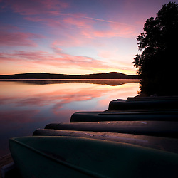 Canoes on the shore of Katahdin Lake before sunrise in Maine's Baxter State Park.  Katahdin Lake Wilderness Camp.