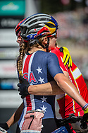 Kate Courtney (USA) is congratulated by the 2nd place woman, Annika Langvad (DEN) after winning the Women Elite Cross Country event at the 2018 UCI MTB World Championships - Lenzerheide, Switzerland