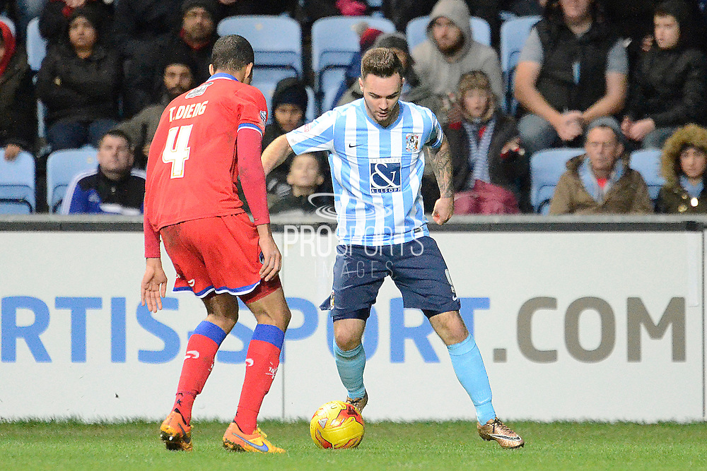 Coventry City striker Adam Armstrong on the ball during the Sky Bet League 1 match between Coventry City and Oldham Athletic at the Ricoh Arena, Coventry, England on 19 December 2015. Photo by Alan Franklin.