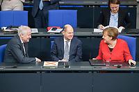 21 MAR 2019, BERLIN/GERMANY:<br /> Horst Seehofer (L), CSU, Bundesinnenminister, Olaf Scholz (M), SPD, Bundesfinanzminister, und Angela Merkel (R), CDU, Bundeskanzlerin, im Gespraech, vor Beginn der Bundestagsdebatte zur Regierungserklaerung der Bundeskanzlerin zum Europaeischen Rat, Plenum, Deutscher Bundestag<br /> IMAGE: 20190321-01-013<br /> KEYWORDS: Gespräch, Handshake