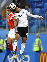 SAINT PETERSBURG, June 19, 2018  Roman Zobnin (L) of Russia competes for a header with Amr Warda of Egypt during a Group A match between Russia and Egypt at the 2018 FIFA World Cup in Saint Petersburg, Russia, June 19, 2018. Russia won 3-1. (Credit Image: © Chen Yichen/Xinhua via ZUMA Wire)