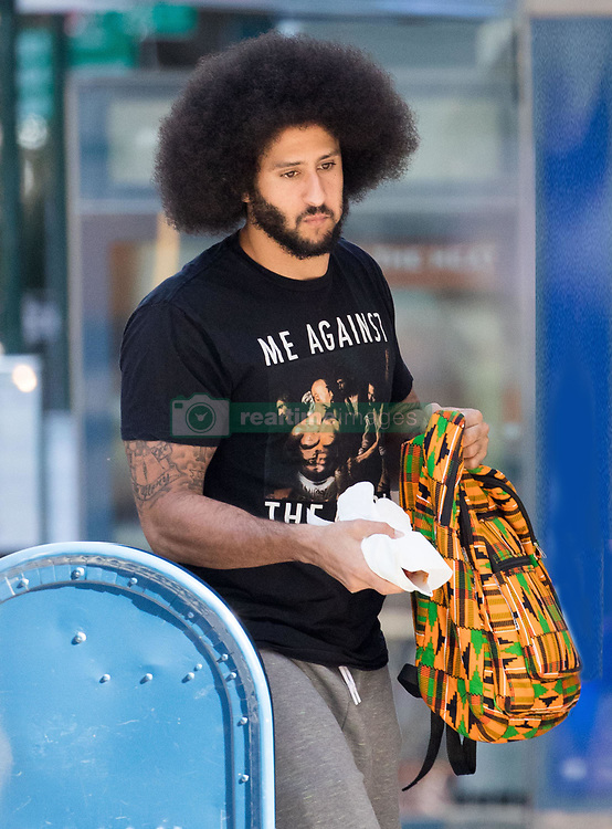 """EXCLUSIVE: ***PREMIUM RATES APPLY*** Free-agent NFL quarterback, Colin Kaepernick was spotted earlier today wearing a Tupac Shakur t-shirt which reads, """"Me Against The World"""" as he was walking in Manhattan. The footballer is credited with starting the trend for NFL players to take the knee during the playing of the Star Spangled Banner before matches. ***NO NEW YORK DAILY NEWS, NO NEW YORK TIMES, NO NEWSDAY***. 27 Sep 2017 Pictured: Colin Kaepernick. Photo credit: MEGA TheMegaAgency.com +1 888 505 6342"""