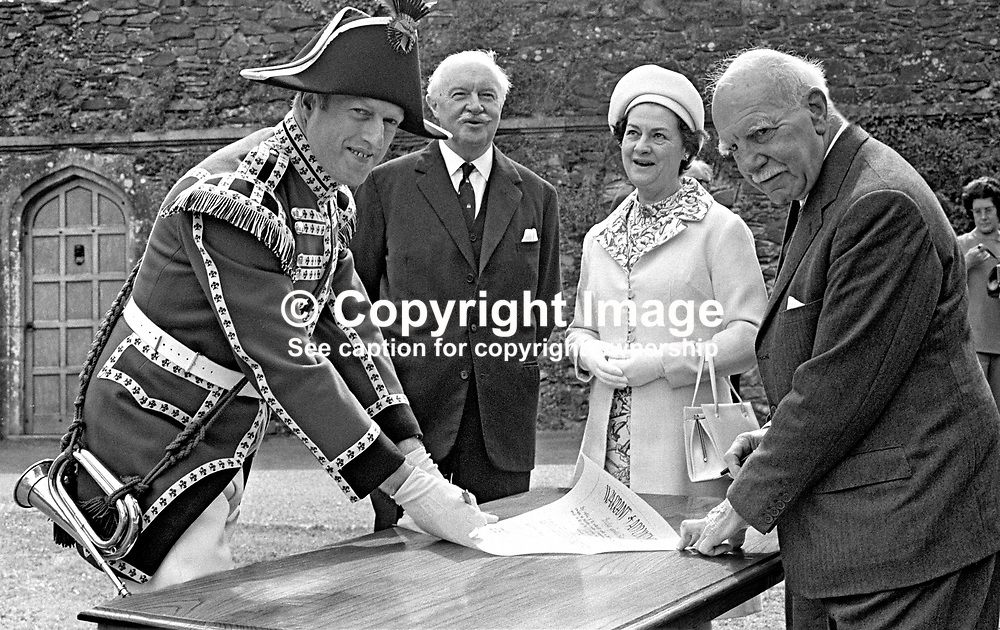 Bugler Gerald Silcock, the only member of the Hillsborough Guard, on the occasion of his commissioning by the Marquis of Downshire. He is seen receiving his warrant from the Marquis. Also in the picture are Lord Grey, Governor of N Ireland, and Lady Grey. The ceremony took place at the Old Fort near the centre of the village in N Ireland, UK. 19713220257d.<br /> <br /> Copyright Image from Victor Patterson, Belfast, UK<br /> <br /> t: +44 28 9066 1296 (from Rep of Ireland 048 9066 1296)<br /> m: +44 7802 353836<br /> e: victorpattersonbelfast@gmail.com<br /> <br /> www.images4media.com<br /> <br /> Please see my full Terms and Conditions of Use at https://www.images4media.com/p/terms-conditions - it is IMPORTANT that you familiarise yourself with them.<br /> <br /> Images used online incur an additional cost. This cost should be agreed in writing in advance. Online images must be visibly watermarked i.e. © Victor Patterson or that of the named photographer within the body of the image. The original metadata must not be deleted from images used online.<br /> <br /> This image is only available for the use of the download recipient i.e. television station, newspaper, magazine, book publisher, etc, and must not be passed on to a third party. It is also downloaded on condition that each and every usage is notified within 7 days to victorpattersonbelfast@gmail.com.<br /> <br /> The right of Victor Patterson (or the named photographer) to be identified as the author is asserted in accordance with The Copyright Designs And Patents Act (1988). All moral rights are asserted.