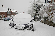 Buried car in Moseley during heavy snow fall on Sunday 10th December 2017 in Birmingham, United Kingdom. Deep snow arrived in much of the UK, closing roads and making driving treacherous, while many people simply enjoyed the weather.