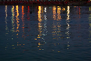 Colour lights reflecting in water in a harbour (Chania, Crete, Greece)