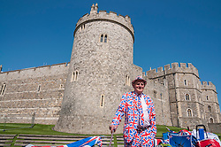© Licensed to London News Pictures. 20/04/2016. Windsor, UK. Terry Hutt, 82, in a Union Jack suit, is one of the keen royal fans who will camp out overnight in order to be in prime position in order to see The Queen as she takes part in a walkabout outside Windsor Castle tomorrow her 90th birthday tomorrow. Photo credit : Stephen Chung/LNP