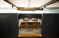 Partitioned seating offers diners a more intimate setting at the Faro Italian Grille in Weirs Beach.  (Karen Bobotas/for the Laconia Daily Sun)