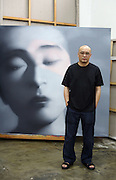 Chinese contemporary artist Zhang Xiaogang, in his Beijing studio. At a time when China's contemporary-art scene is sizzling, with dozens of galleries opening in Beijing and other cities and works being auctioned for record prices, few artists are as celebrated as Mr. Zhang, whose paintings can now fetch as much as $200,000 each.