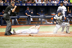 August 4, 2017 - St. Petersburg, Florida, U.S. - WILL VRAGOVIC   |   Times.Tampa Bay Rays left fielder Corey Dickerson (10) reacts after being called out on the tag by Milwaukee Brewers catcher Manny Pina (9) while attempting to score on the double by Tampa Bay Rays third baseman Evan Longoria (3) to end the seventh inning of the game between the Milwaukee Brewers and the Tampa Bay Rays at Tropicana Field in St. Petersburg, Fla. on Friday, August 4, 2017. (Credit Image: © Will Vragovic/Tampa Bay Times via ZUMA Wire)