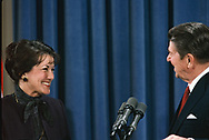 President Ronald Reagan answers questions from the press and announces that he has selected Elizabeth Dole as the Secretary of Transportation in January 1983<br />Photo by Dennis Brack