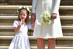 Princess Charlotte holds the hand of her mother the Duchess of Cambridge after attending the wedding ceremony of Prince Harry and Meghan Markle at St George's Chapel, Windsor Castle.
