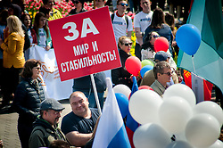 May 1, 2019 - Tambov, Tambov region, Russia - Meeting in honor of the Spring and Labor day ( may 1, 2019. The City Of Tambov (Russia). Participant of the may day rally with a poster  (Credit Image: © Demian Stringer/ZUMA Wire)