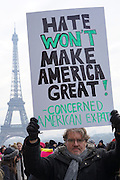 January, 21st, 2017 - Paris, Ile-de-France, France: January, 21st, 2017 - Paris, Ile-de-France, France: Protesters with 'Hate won't make America Great' placard at Trocadero. Thousands of protesters in Paris join anti-Trump Women's March around the world.