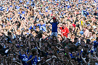 Football - 2017 / 2018 Sky Bet Championship - Cardiff City vs. Reading<br /> <br /> Young fan stands on the shoulders of other fans as they cover the pitch at he end of the game, as Cardiff are promoted to the Premier League at Cardiff City Stadium.<br /> <br /> COLORSPORT/WINSTON BYNORTH