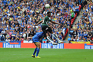 Plymouth Argyle striker Jamille Matt (19) jumps Darius Charles defender for AFC Wimbledon (32) during the Sky Bet League 2 play off final match between AFC Wimbledon and Plymouth Argyle at Wembley Stadium, London, England on 30 May 2016. Photo by Stuart Butcher.