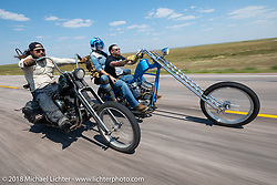 Danger Dan riding his Shovelhead beside Bobbi and Clinton Wallace on Clinton's super long 1952 Panhead chopper in the Cycle Source Ride during the 78th annual Sturgis Motorcycle Rally. Sturgis, SD. USA. Wednesday August 8, 2018. Photography ©2018 Michael Lichter.