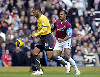 Photo: Olly Greenwood.<br />West Ham United v Arsenal. The Barclays Premiership. 05/11/2006 Arsenal's Thierry Henry and West Ham's Anton Ferdinand